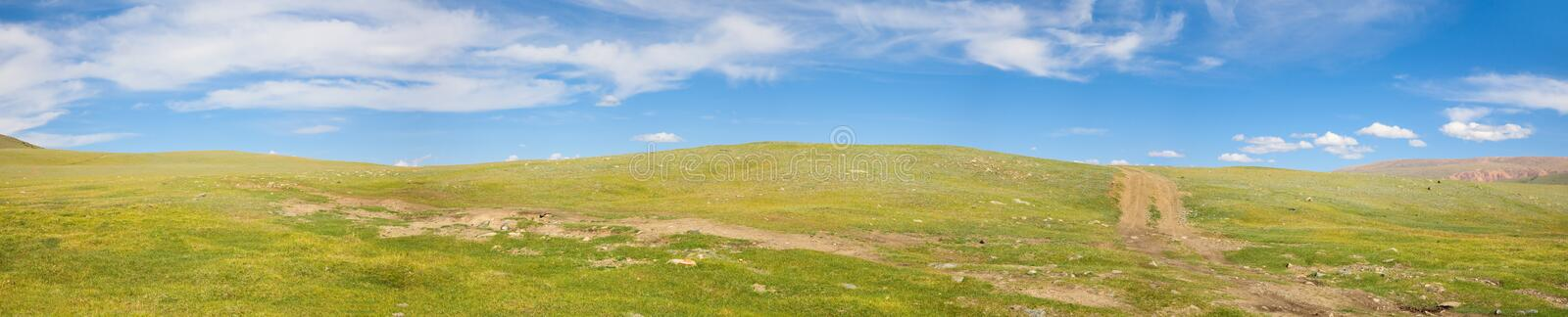 Road in the mountain steppes royalty free stock photography