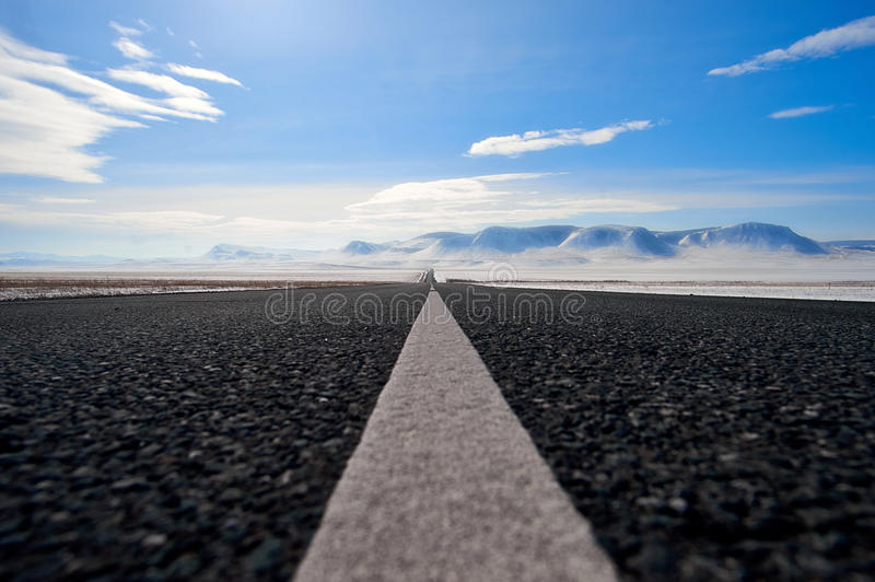 Road in the mountain steppes in the winter. Close up stock photos
