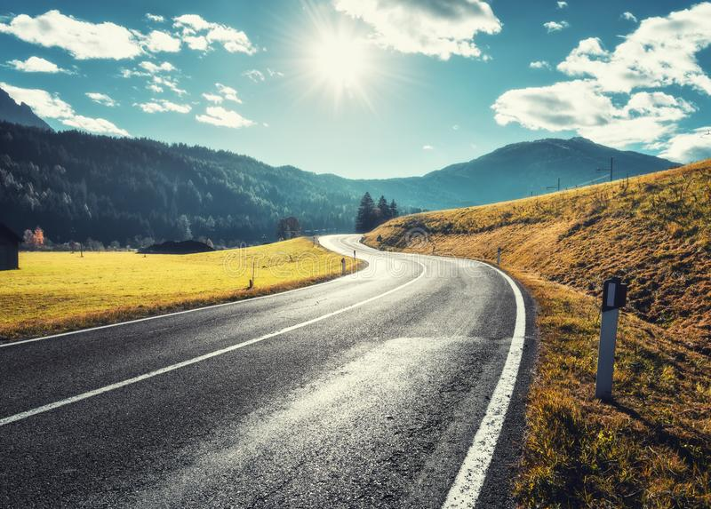 Road in mountain valley at sunny morning in Dolomites, Italy royalty free stock images