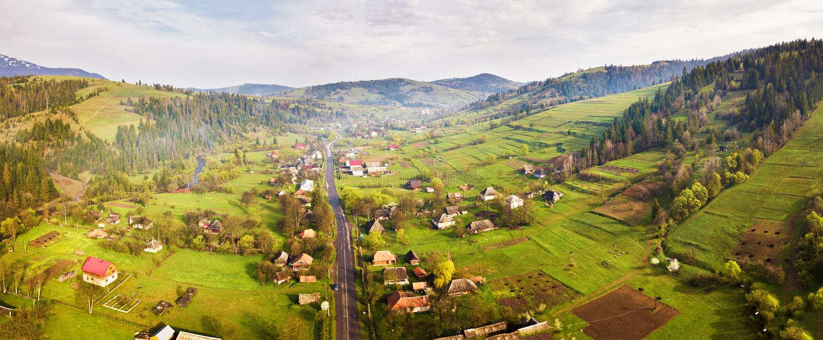 Road in mountain village. Aerial Panorama of Carpathian valley royalty free stock photos