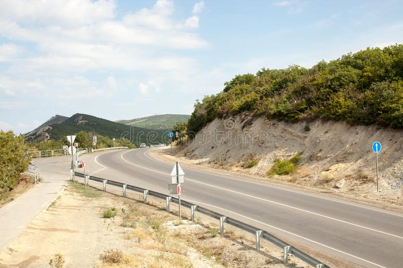 Road in mountainous area with trees in the afternoon. Travel to natural places. Outdoor recreation. Landscapes on the road. Background image royalty free stock images