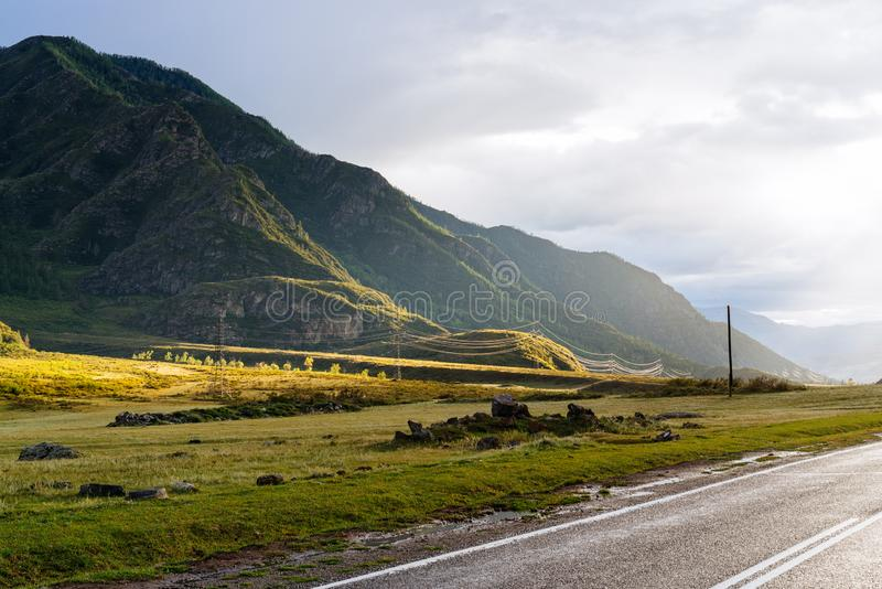 Road in the mountains against in the evening light. Road in the mountains against a beautiful evening light royalty free stock photography