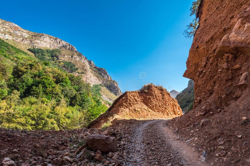 Road in the mountains. Dirt road in the mountains stock photography