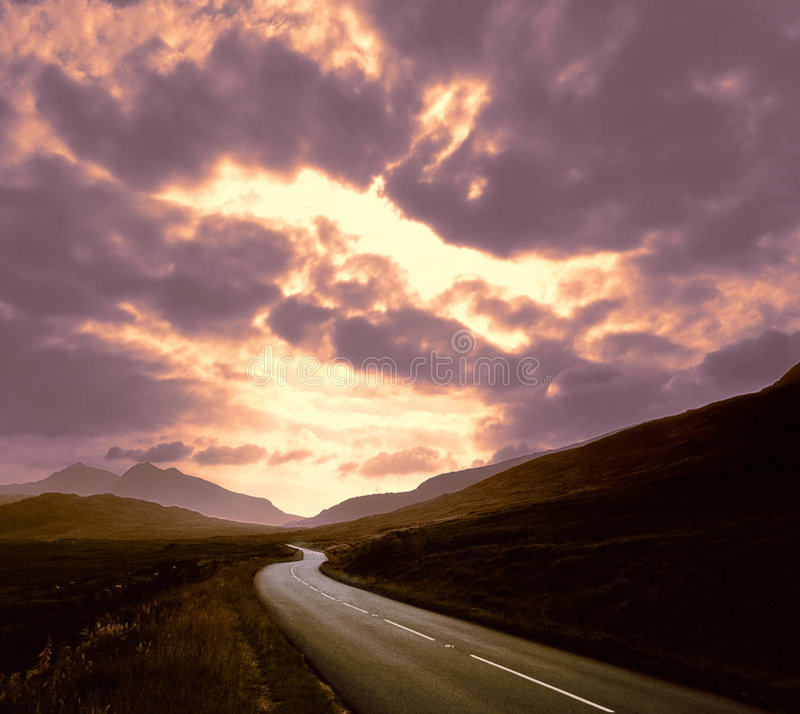 Download Road Through Mountains Sunset Stock Photos - Image: 1405603
