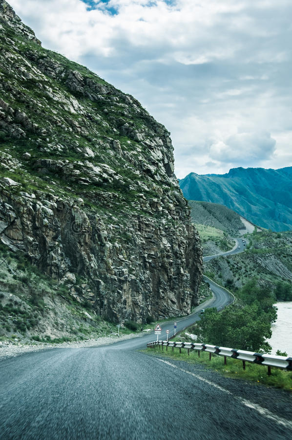 Road in the mountains. Valley. Altai, Siberia royalty free stock photo