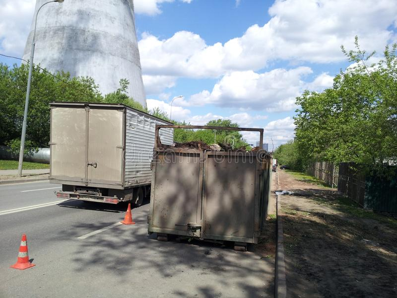 Road-mounted solid waste container collection on the roadway General Dorokhov street royalty free stock photography