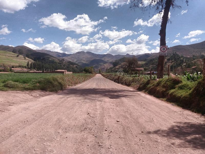road close to corn cultivation stock image