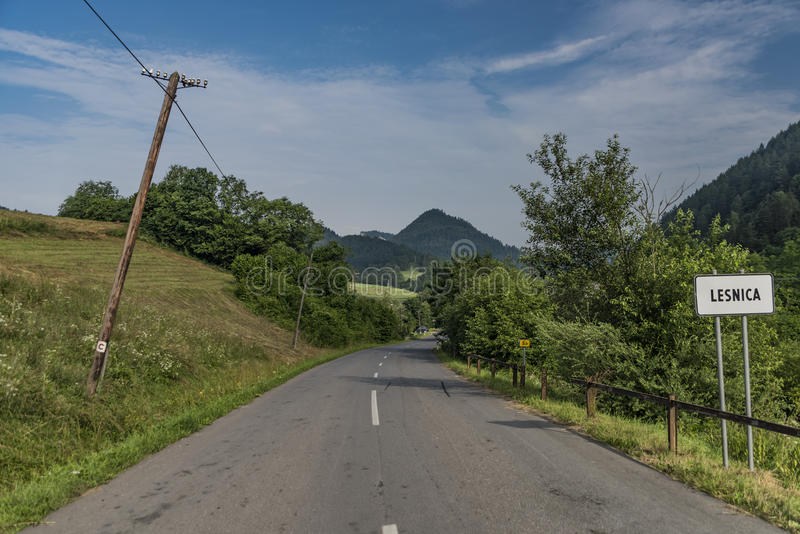 Road near Lesnica village in Pieniny national park. In cold summer morning stock image