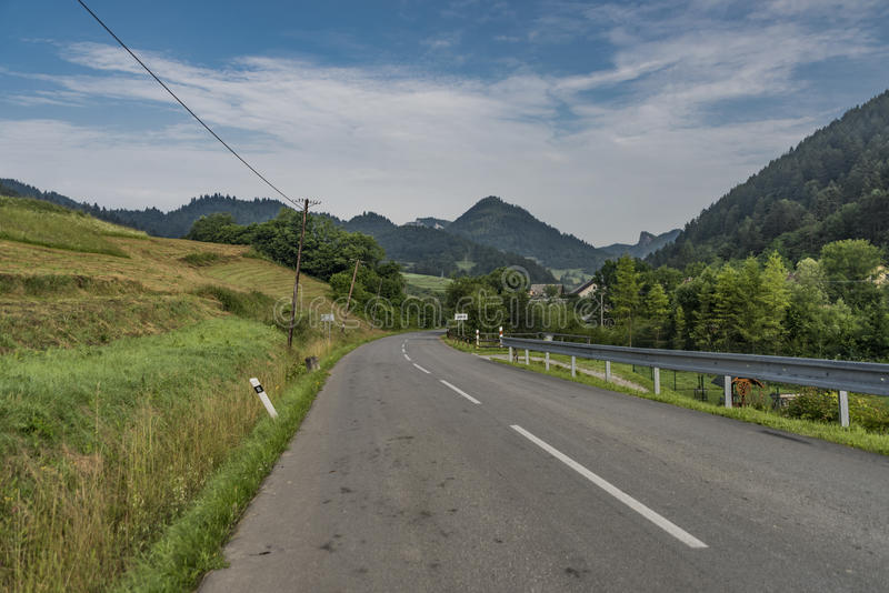 Road near Lesnica village in Pieniny national park. In cold summer morning stock images