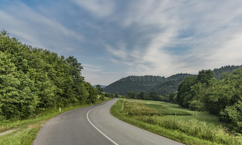 Road near Lesnica village in Pieniny national park. In cold summer morning stock photos