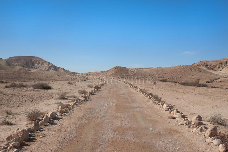 Road at Negev desert stock photography