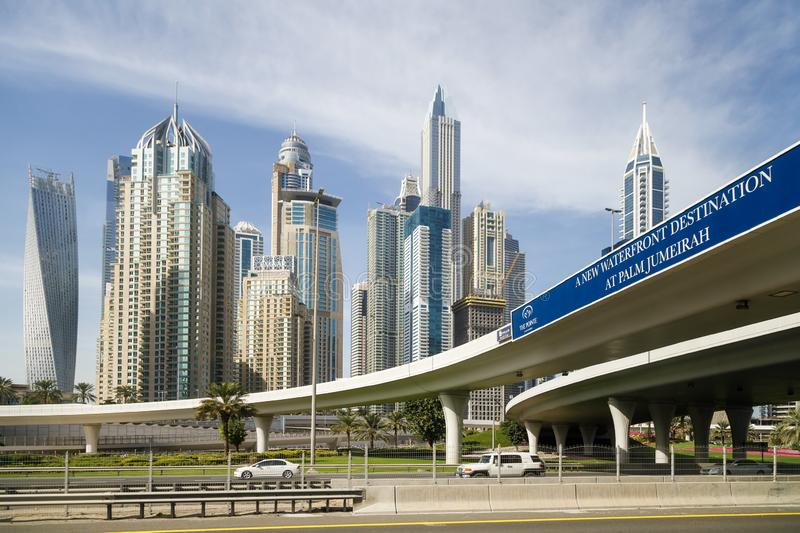 Road of new waterfront destination at Palm Jumeirah on the background of modern beautiful high-rise buildings stock photos