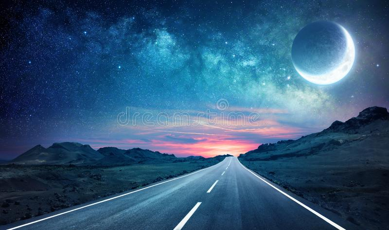Road In Night - With Half Moon royalty free stock photo