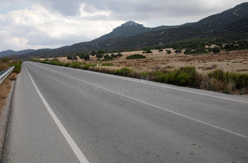 Road in Northern Cyprus. Landscape with road stretches into the distance against the backdrop of mountains stock images