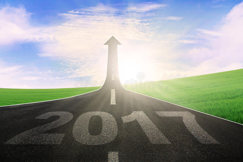 Road with number 2017 and upward arrow. Image of an empty highway with number 2017 and upward arrow. Symbolizing better future stock photo