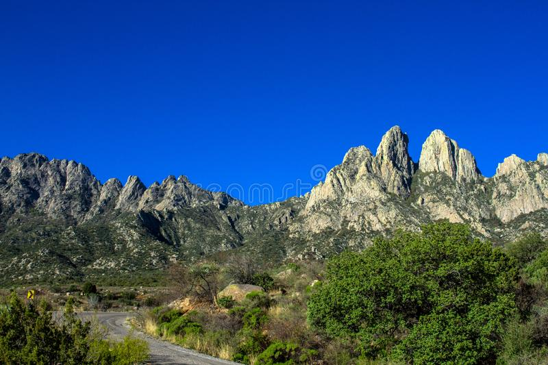Road into the colorful peaks of Organ Mountains-Desert Peaks National Monument in New Mexico. Scenic drive into the colorful peaks of Organ Mountains-Desert stock image