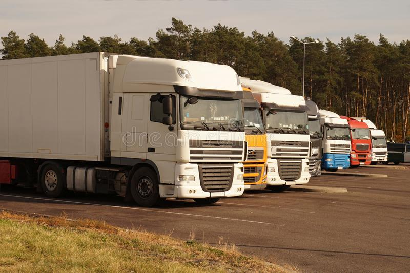 Road parking. Trucks set in a row on the driver`s rest area. Trucks set in a row on the driver`s rest area. Road parking stock photos