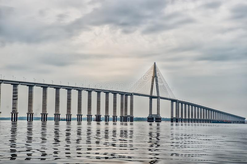 Road passage over water on cloudy sky. Bridge over sea in manaus, brazil. architecture and design concept. Travel destination and. Wanderlust stock photo