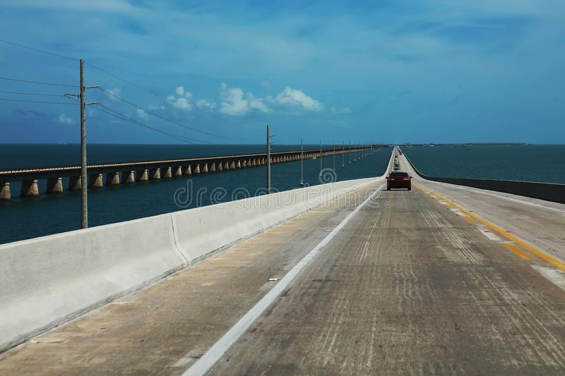 Road passes through a beautiful wide ocean and goes beyond the h. Orizon, the background stock photo