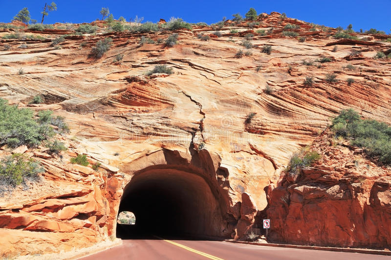 The road passes through a tunnel stock photos