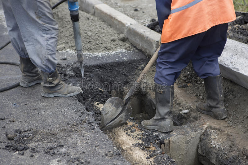 Road Paving. Workers laying stone mastic asphalt during street r. Road Paving Construction. Workers laying stone mastic asphalt during street repairing works royalty free stock image