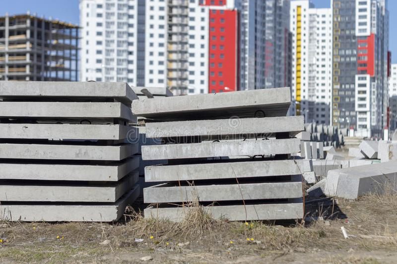 Road plates, floor slabs on the construction site. Of a house under construction stock photos