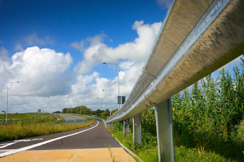 Road With Protective Metal Side Fence And Sky Stock Image