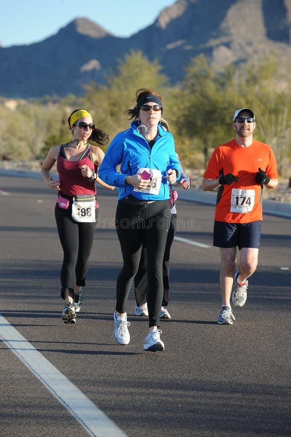 Road Race Runner. Five mile race in Phoenix Arizona during the winter stock image
