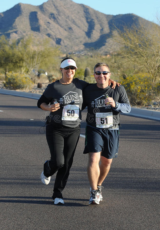 Road Race Runner. Five mile race in Phoenix Arizona during the winter royalty free stock photo