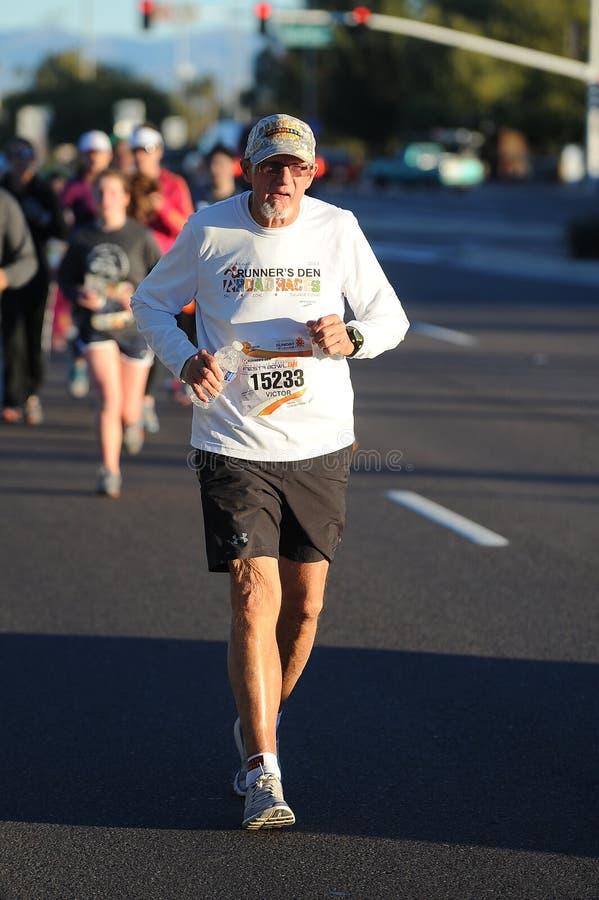 Road Race Runner. Five mile race in Phoenix Arizona during the winter stock photo