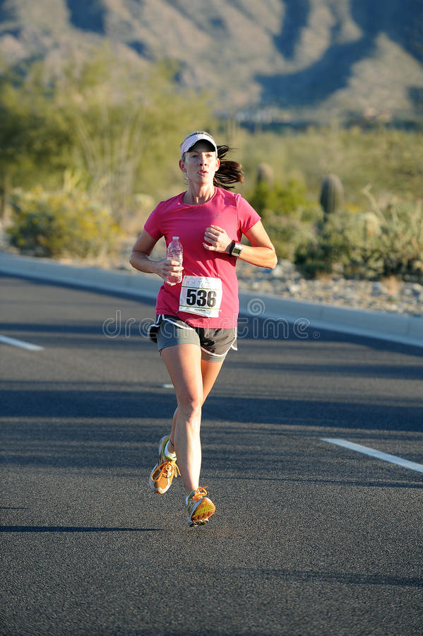 Road Race Runner. Five mile race in Phoenix Arizona during the winter royalty free stock photos