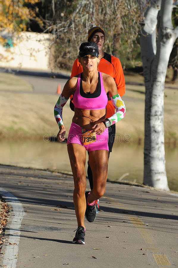Road Race Runner. Five mile race in Phoenix Arizona during the winter stock photography