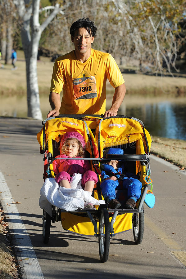 Road Race Runner. Five mile race in Phoenix Arizona during the winter royalty free stock image
