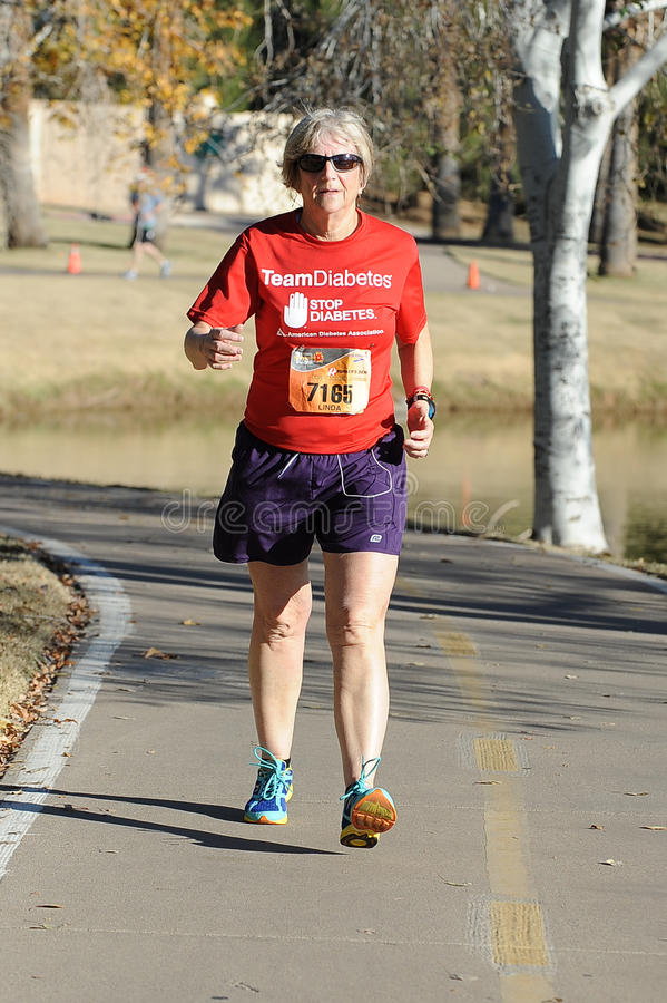 Road Race Runner. Five mile race in Phoenix Arizona during the winter in the park royalty free stock photography