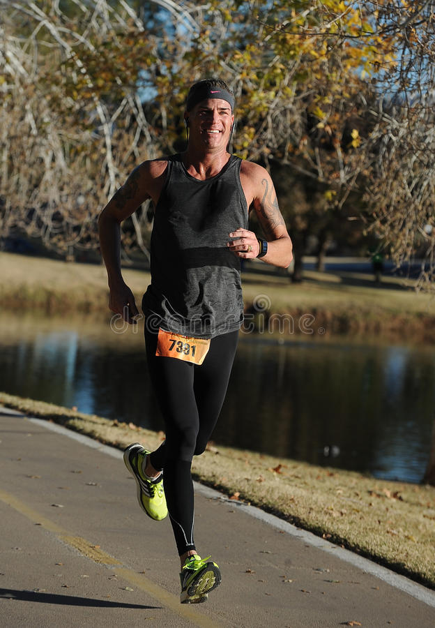 Road Race Runner. Five mile race in Phoenix Arizona during the winter in the park stock photography