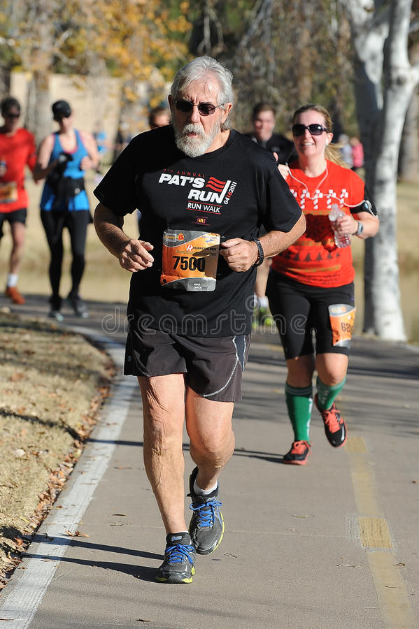 Road Race Runner. Five mile race in Phoenix Arizona during the winter in the park stock photo