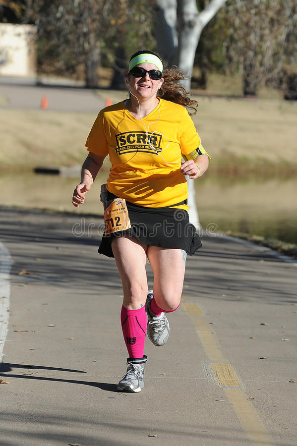 Road Race Runner. Five mile race in Phoenix Arizona during the winter in the park royalty free stock photo