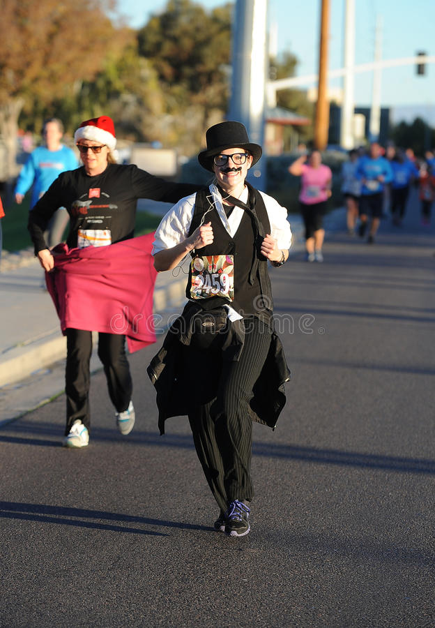 Road Race Runner. Five mile race in Phoenix Arizona during the winter in the park royalty free stock image