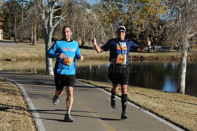 Road Race Runner. Five mile race in Phoenix Arizona during the winter in the park stock photos