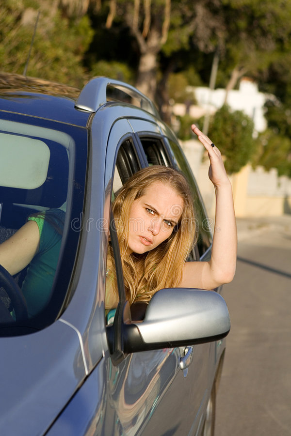 Road rage, angry woman in car stock photos