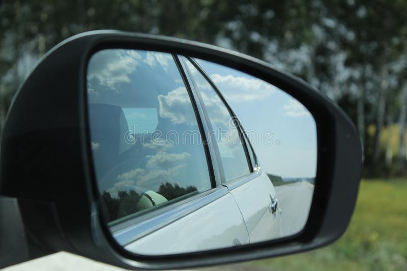 Road reflection in the mirror stock image