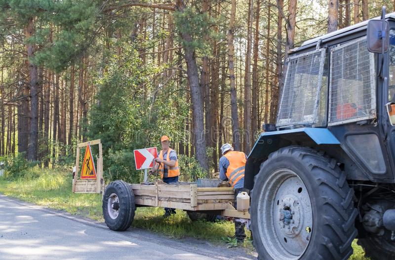 Road repair by a team of professional builders royalty free stock images