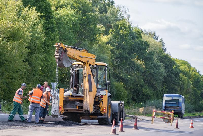 Road repair by a team of professional builders royalty free stock photo