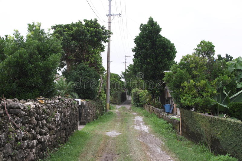 Road of residential area not paved on remote island of Okinawa royalty free stock photos