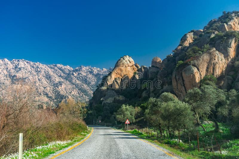 Road and  rock detail from Latmos Besparmak Mountain. Milas, Aydin, Turkey royalty free stock photos