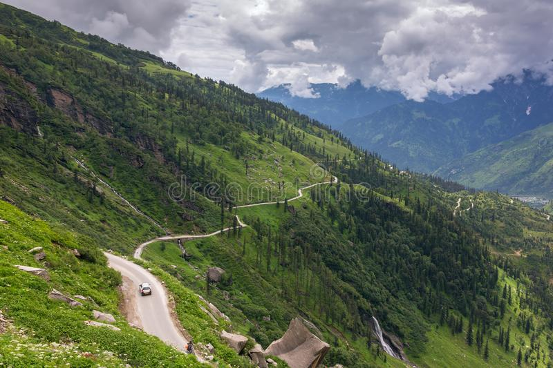 Road from Rohtang pass through the beautiful green Kullu valley in Himachal Pradesh state stock photos