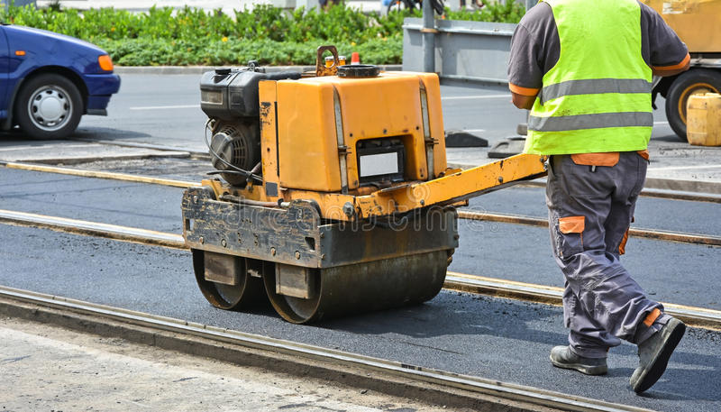 Road roller at work stock images