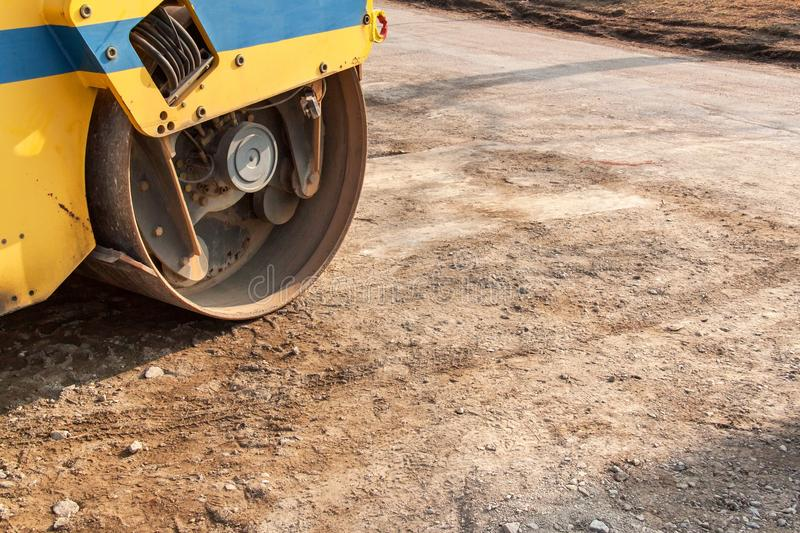 Road roller working at road construction site. Detailed view of a road roller. Construction work. Road roller working at road construction site. Detailed view stock photo