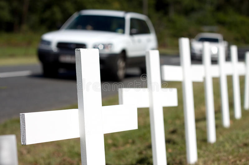 Road Safety. Roadside memorial crosses in a traffic safety theme. Focus on leading cross. Plenty of Copy Space to highlight your road safety message royalty free stock photos