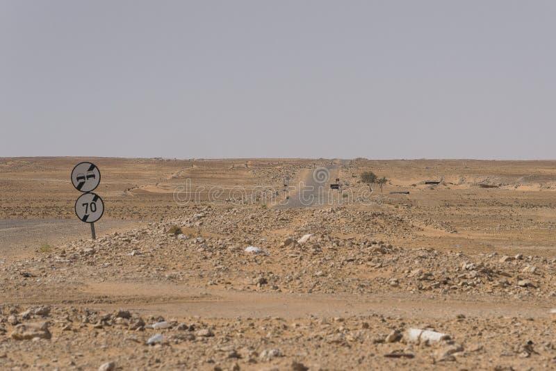 Road on Sahara. A road through Sahara desert in Tunisia , Africa stock photos